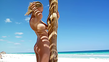 Sweet blondie reveals her perfect buns and melons while being nude at the ocean, under the bright sun which makes her body look even hotter.