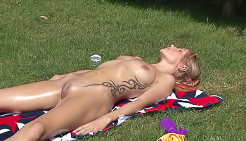 Naked chicks are sunbathing in the street. The blonde having small tits is torturing her juicy pussy with her fingers to feel the great orgasm.